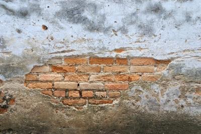 Muro antigo de tijolos em analogia com a anatomia da pele.